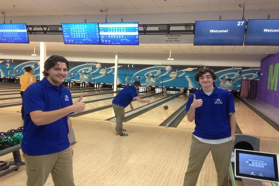 Richard Cadario '17 and Scott Stone '17 standing by as Jake Collins '17 bowls a frame.