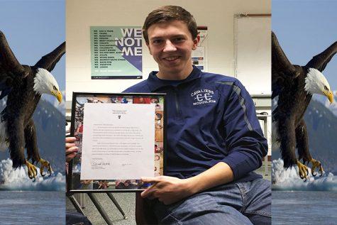 Adam McQuilkin '18 presenting his Eagle Scout certificate.