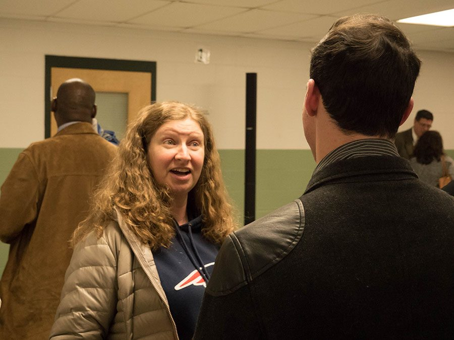 English teacher Heidi Foster congratulates Bloniasz on speaking up during the forum.