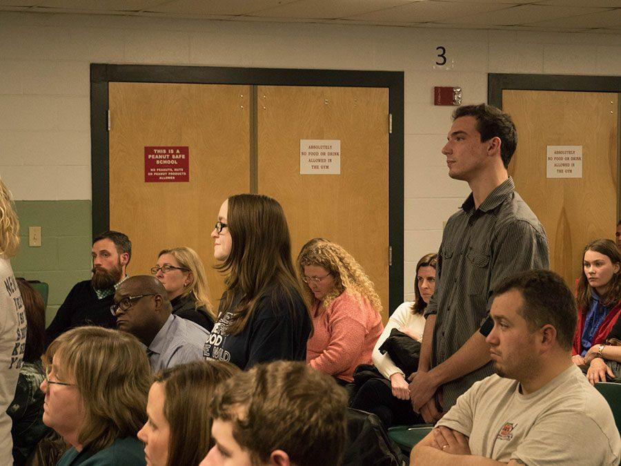 Caitlin Ross '17 and Patrick Bloniasz '18 wait patiently to speak in front of the community.