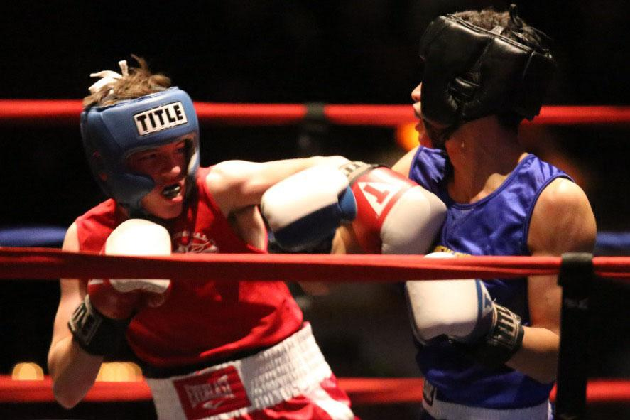 Christian Moura '17 throwing a left hook during a boxing match