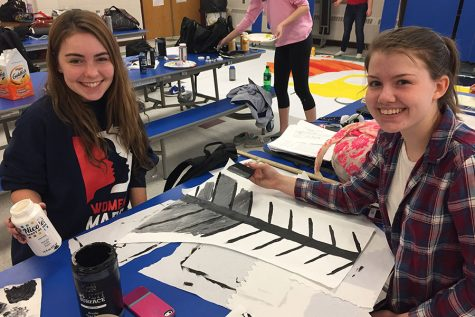 Emma Bruseo '17 and Meghan Corban '17 help with details on the seniors' poster.