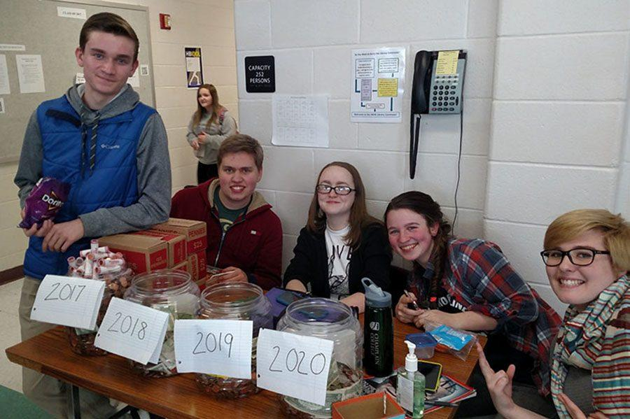 Students+sitting+with+the+class+jars+on+the+last+day+of+Penny+Wars.+From+left+to+right%3A+Nathan+Buckley+%2717.+Chris+Aulbach+%2717%2C+Caitlin+Ross+%2717%2C+Audra+Paradie+%2717%2C+and+Abby+Lewis+%2717.