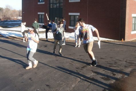 The sophomore class practices their Spirit Week skit outside.