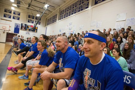 HB Staff sits on the side during the Staff vs. Unified game.