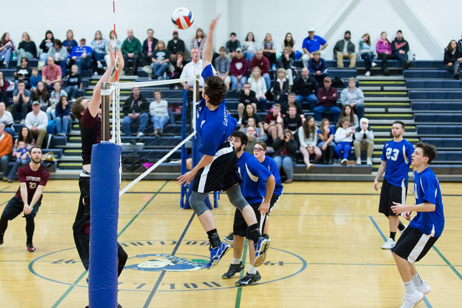 Nick Wood '17 about to spike the ball during their senior night game.