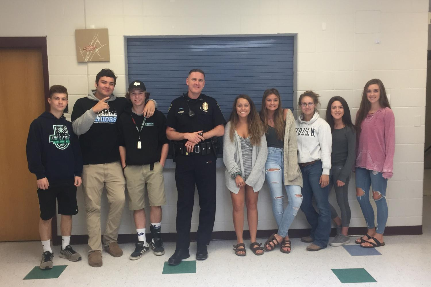Students pose with their favorite SRO.