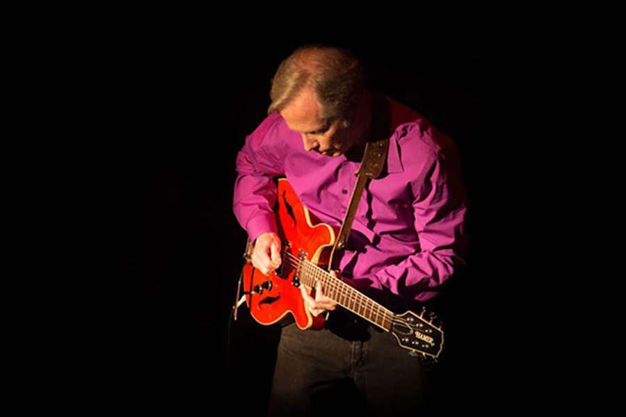 """Mr. I appears lost in the music. Guitar Night has established itself as a staple of the Hollis Brookline school year. When prompted as to his feelings about Guitar Night, Steven Szczeszynski 20' said """"It's pretty good."""""""