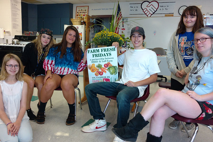"Students pose with the Farm Fresh poster. Students Eryn Bavis '18, Shannon Heidel '18, Emma Moir '18, Rhiannon Shebak '18, Ashlyn Bodholdt '18, Richard Huppe '18 are in Foods and Nutrition 2 and are helping out with the Farm Fresh Fridays for the month of October. ""I think the food is tasty if you cook it right,"" Emma Moir said."