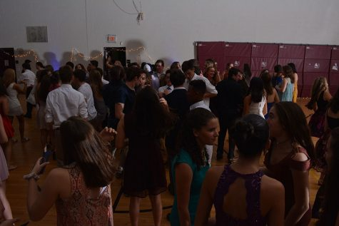 """Students enjoy socializing and dancing in the mini gym. Adam McQuilkin '18, photographer and Senior student council president, said, """"Homecoming was a huge success, it came out better than I could have hoped thanks to the wonderful Mr. Perry and Ms. Ainsworth-Brown, our class advisers, and the HB student body."""""""