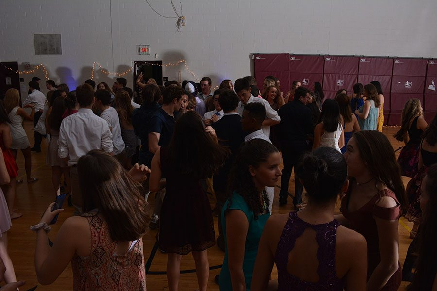 Students+enjoy+socializing+and+dancing+in+the+mini+gym.+Adam+McQuilkin+%2718%2C+photographer+and+Senior+student+council+president%2C+said%2C+%E2%80%9CHomecoming+was+a+huge+success%2C+it+came+out+better+than+I+could+have+hoped+thanks+to+the+wonderful+Mr.+Perry+and+Ms.+Ainsworth-Brown%2C+our+class+advisers%2C+and+the+HB+student+body.%E2%80%9D