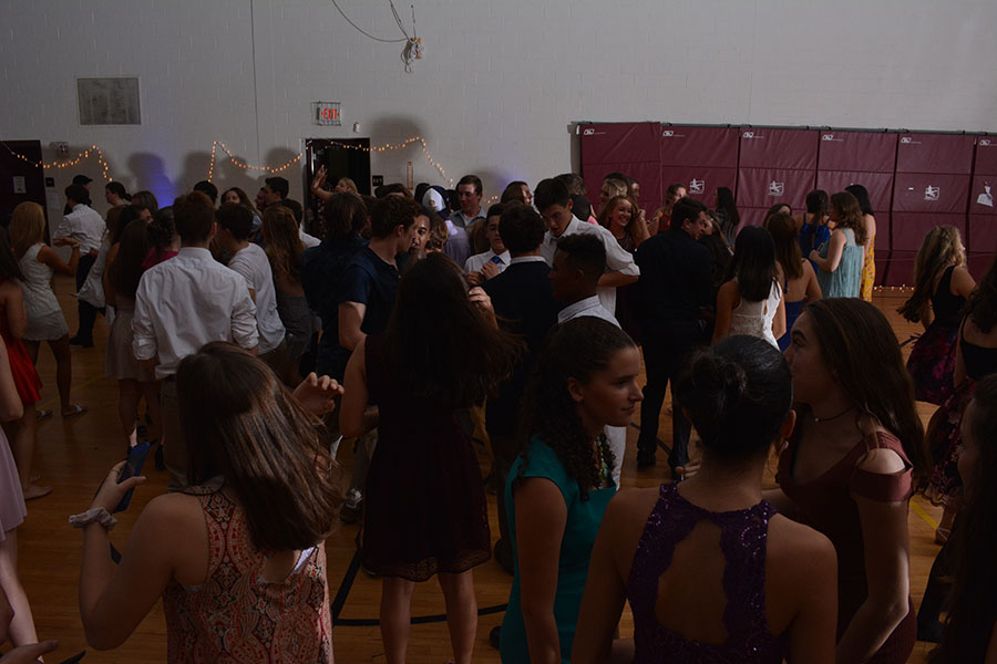 "Students enjoy socializing and dancing in the mini gym. Adam McQuilkin '18, photographer and Senior student council president, said, ""Homecoming was a huge success, it came out better than I could have hoped thanks to the wonderful Mr. Perry and Ms. Ainsworth-Brown, our class advisers, and the HB student body."""