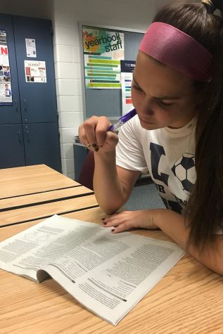 "Thinking hard, Tasha White '20 sits quietly, going through the PSAT study guide. ""I'm practicing for the practice in hopes I can earn a scholarship,"" told White."