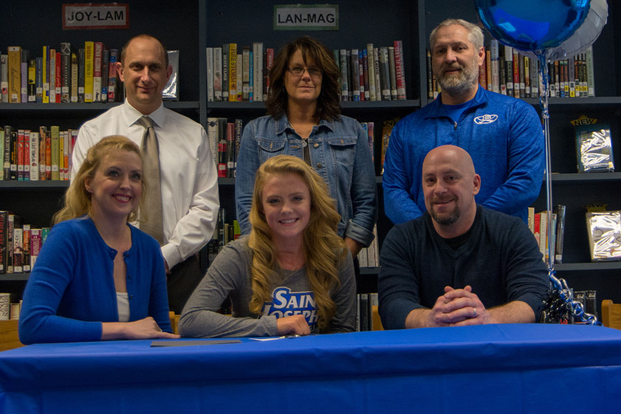 Meghan Hill '18 and her parents sit front row with (left to right) Principal Richard Barnes, Coach Tracie Thorp, and Athletic Director Ron Rupp in back. Hill signed to play field hockey with St. Joseph's of Maine on Thursday.