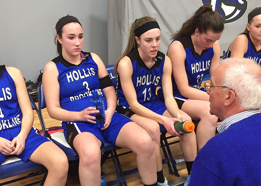 "Joanna Balsamo '18, Brodie Kelley '19, and Elizabeth Atkinson '19 look on to coach Bob Murphy during a timeout at their game against Pelham on Tuesday. The team has had a solid season so far and continues to work hard on and off the court. ""I am most proud of how even though everyone doesn't get in the game, everyone is focused and either playing hard or cheering on their teammates. It's amazing to see everyone giving their 100%!"" said captain Balsamo."