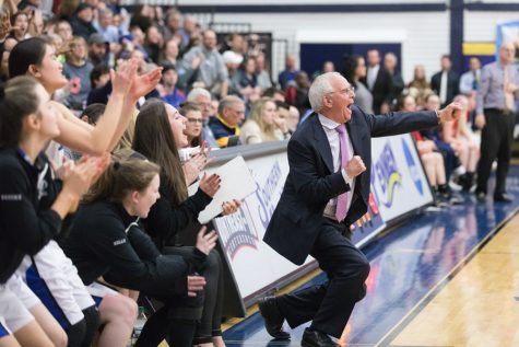 Coach Bob Murphy and the bench celebrating during the game. The girls took home Hollis Brookline's first girls basketball title on Friday night.