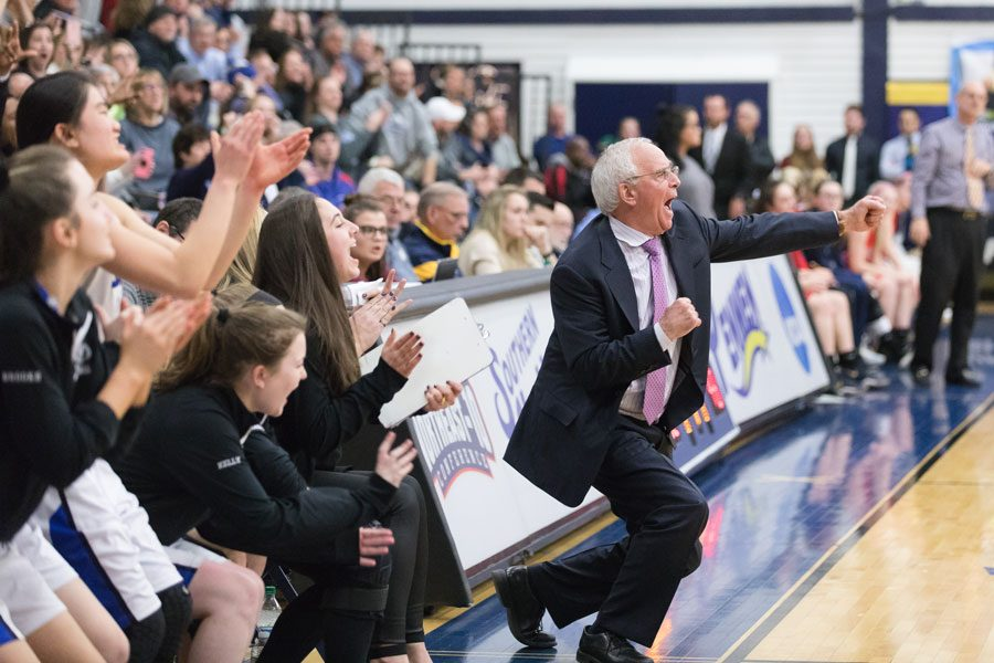Coach+Bob+Murphy+and+the+bench+celebrating+during+the+game.+The+girls+took+home+Hollis+Brookline%27s+first+girls+basketball+title+on+Friday+night.