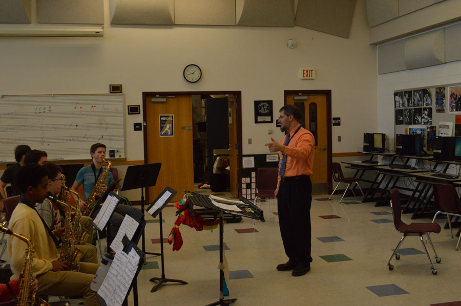 Mr. Umstead starts off every class by informing the students on upcoming events, news, local gigs and events, or even going over previous concerts or workshops. During his seventh period Jazz class he discusses the upcoming UNH festival and the extra tickets he has for students who are interested.