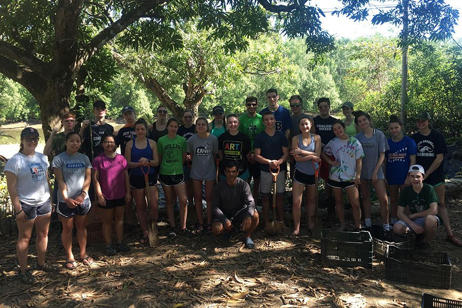 "Students on the Costa Rica trip stand together after they finished digging and replanting seeds to bring wildlife to the shores. The trip consisted of activities to help out the community and preserve the land along the river. ""It feels good that all the work we put in will help so many people in the future, and we all became a lot closer while we were doing it,"" said Meghan Veino '20."