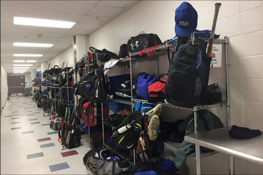 """Students struggle through a pile of sports gear in order to find a place for their bags. A new system could help to decrease the disorganization and help athletes of every sport. """"A new system would help the organization process,"""" Rachael Brown '20."""
