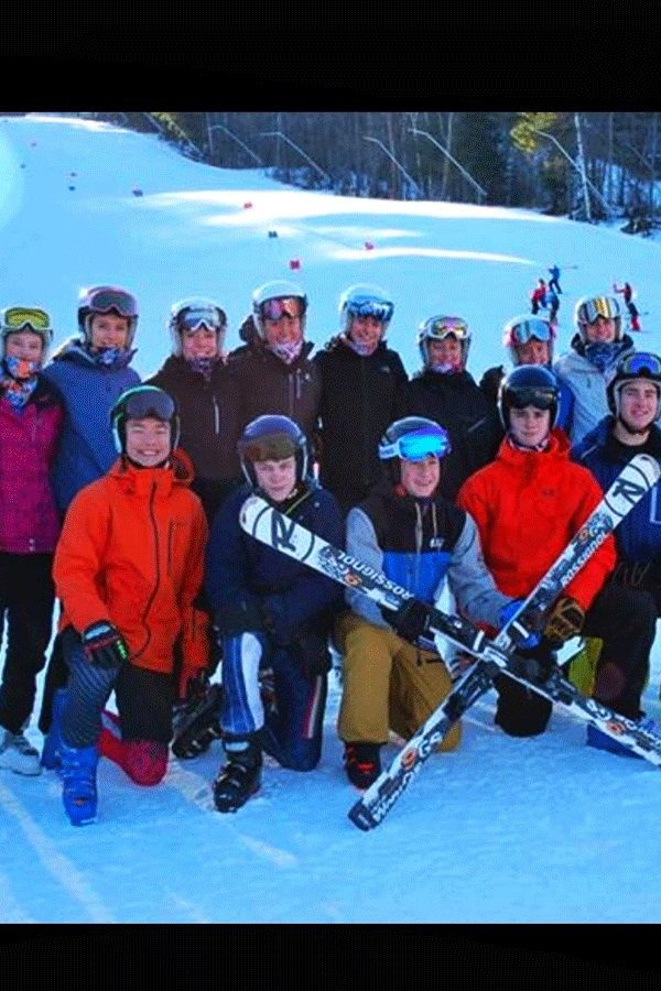 "Both the Hollis Brookline Boys' and Girls' Alpine Ski Teams pose for a team picture on the snow at Sunapee Ski Mountain and Resort. At the Sunapee competition, the girls' team had one of their sweeping wins, coming in first place overall. While that win was incredible for the team, both the boys and girls teams said that it was the teamwork that lead them to every success. ""The dynamics of the team improved a lot and we became a lot closer,"" said Lysik."
