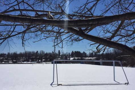 """The HB soccer/baseball field lays covered in snow during the winter offseason. As soon as the snow melts, the field will once again be overused with the constant need of field space. """"A turf field would be a huge help to the football team and HB sports in general"""", said Brown '19."""