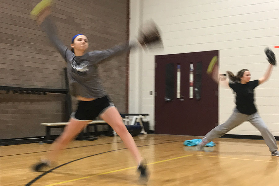 "Varsity team members, Gabby Paquin '19 and Cassidy Pigott '19 pitch in the mini gym during tryouts. Both girls will be returning varsity members.""Having some fun while kicking some butt is kind of the plan… as far as I know,"" said Assistant Coach Gray."