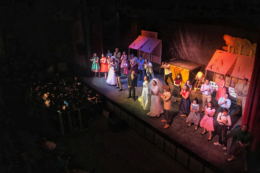 "The cast of All Shook Up stands together on stage in one of the last scenes in Act II. The cast members have been working on performing their show for two months and were excited to finally put on a splendid performance for all to see ""The snow days were definitely effective in the timing of putting together the production...we had a lot less time to work on specifics of the musical that needed to have practice...but luckily, everybody in the production is very hardworking and able to cooperate with the near 40 hours of rehearsal time we lost,"" said Evan LaFrance '20."