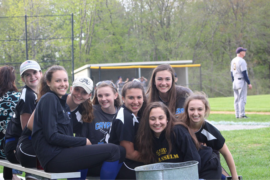 "The softball players all gather together in a silly picture during a game. ""It has come down to one or two innings [each game] where we can't get out of the hole; other than those times- we play very solid"" said Gray."