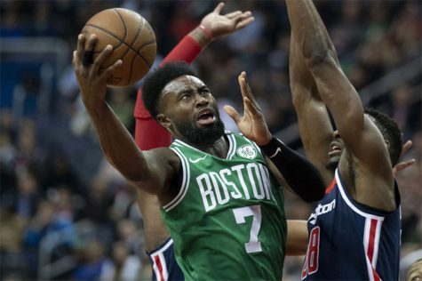 "Jaylen Brown takes the ball to the rim through contact in a game against the Wizards. Despite battling injuries, Brown has been a key part of their success. ""Jaylen now has two years under his belt and settling in, he has really elevated his level of play"" says Michael Moscatelli '19."