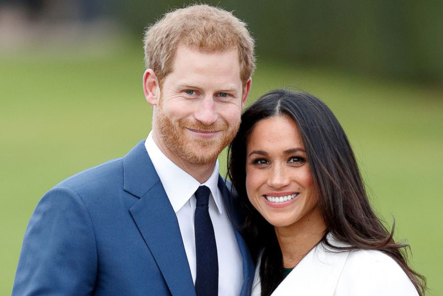 "Prince Harry and his fiancée, Meghan Markle, smile for the camera for an official pre-wedding photo shoot. Meghan Markle is the first biracial woman to marry into the English royal family, and although some discriminatory comments have been targeted at her, the couple's upcoming wedding has been globally celebrated. ""I think [Prince Harry and Meghan Markle] are cute, but he'd be a better match with me, of course,"" said Christina Ellis."