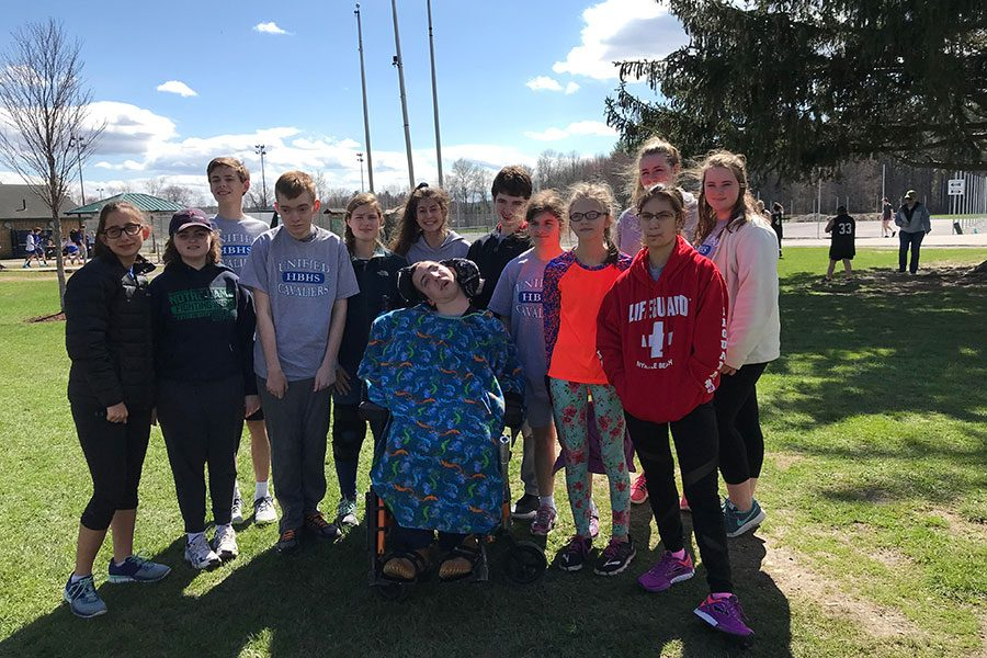 "A couple of athletes and players pose together before their meet on May 1 at Concord High School. The team has been practicing for the past month in preparation for their first meet. ""Everyone was excited for the meet, now we just have to practice to make perfect,"" said Ashlyn Mansfield '19."