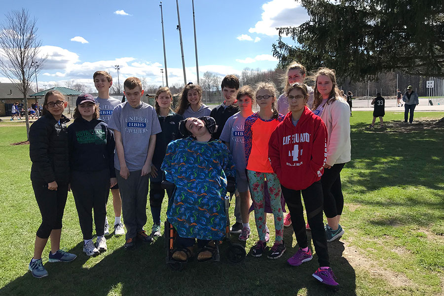 """A couple of athletes and players pose together before their meet on May 1 at Concord High School. The team has been practicing for the past month in preparation for their first meet. """"Everyone was excited for the meet, now we just have to practice to make perfect,"""" said Ashlyn Mansfield '19."""