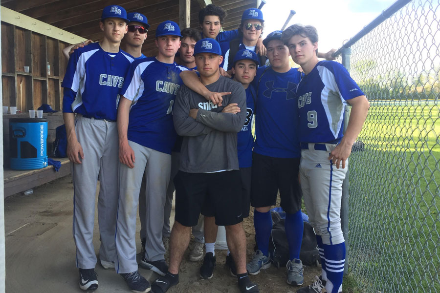 """The boys baseball team poses as a close group after a successful 11-4 win over Milford on May 14 with determination in their eyes. The baseball team had a slow start to their season causing a desperately needed turn around in their play. """"We're gonna make noise this season,"""" said Joe Brown '18 just before their last game on May 23."""