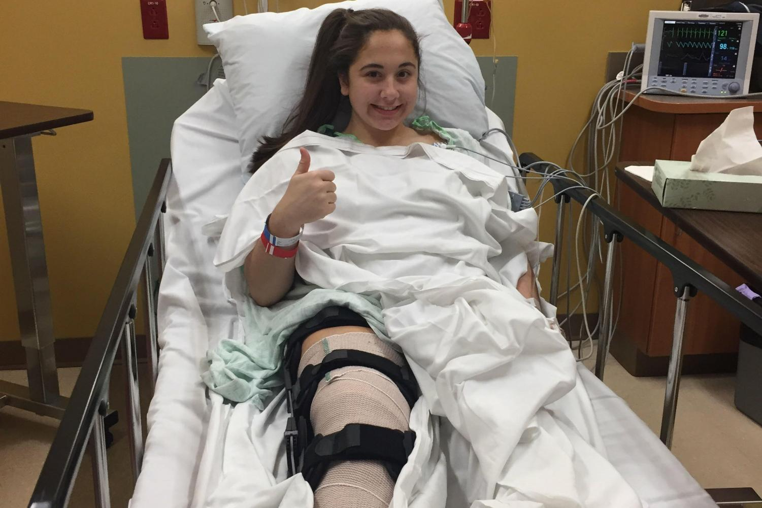 "Pictured is me, Sofia Barassi, sitting in my hospital bed after my ACL surgery in November of 2017. I tore my ACL playing field hockey and thought that it was the end of my career. Now I'm recovered and ready to play my favorite sport again. It was a very scary experience, but Arnold couldn't have stated it better, ""I've learned you need to go hard at what you love to do, because it can be taken from you at any time."""