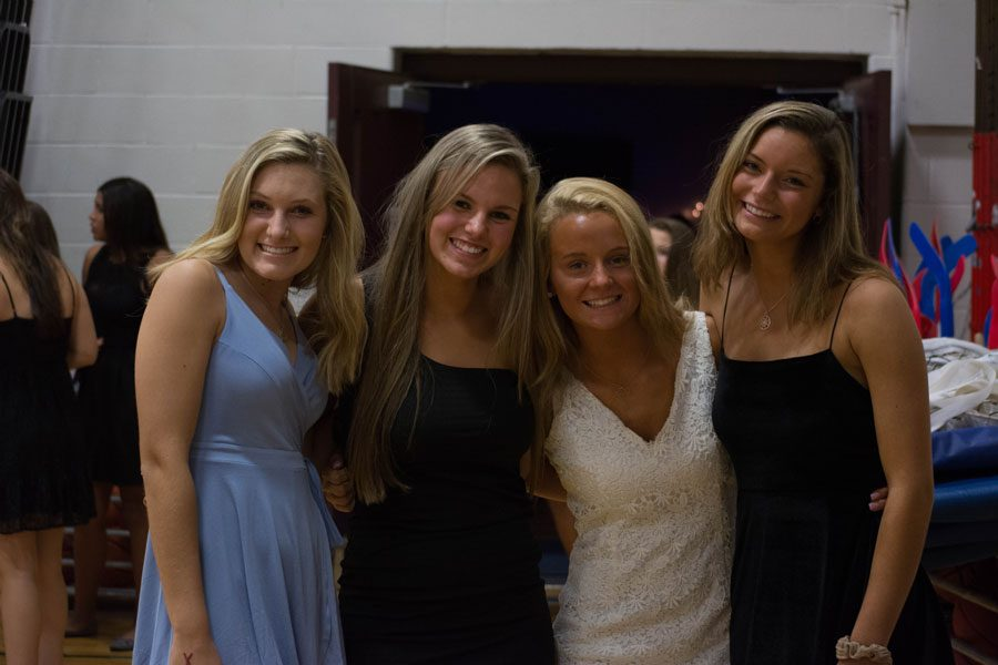 "Students from the 2019 graduating class attend Homecoming 2017 in semi-formal dresses. Historically, HBHS Homecoming has been semi-formal attire, and will continue to be for the pending Harvest Dance. ""We have to define [the dress code] still, but expect it to be semi-formal,"" said Grosse."