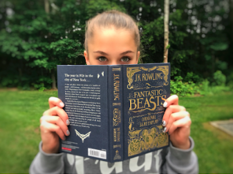 "A young student is encapsulated by the script of the movie Fantastic Beasts and Where to Find Them. JK Rowling wrote the script after becoming attached to one of her created characters, Newt Scamander. ""[In the new movies], you get to think about the 'good ole days of Wizardry' and the origins of everything we know and love about Harry Potter… 'Fantastic Beasts' has this happy, warm lighting. You'll notice everything has something of a tint of yellow, there's like natural sunshine or a rejuvenation of joy that comes with Harry Potter,"" says Milette."