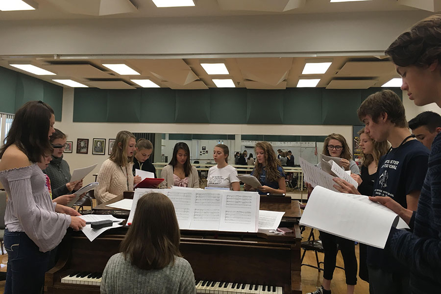 "Fermata Nowhere members sing Dancing On My Own, by Calum Scott, arr. Robin, at their first rehearsal with the addition of newly auditioned members on September 21. Pictured from left to right is Nicole Plummer '19, Megan Mitchell '20, Emily Fox '22, Laurie Houvener '19, Katie Marsano '22, Lia Eisenberg '21, Erin Moynihan '19, Rachel Delong '22, Sam Price '20, Caroline Pack '19, Evan LaFrance '20, Daniel Delong '19 and William Scales '22, with Anna Musteata '22 as the rehearsal pianist. ""I felt like we sounded really good and it's nice to be with a group of people who know what they're doing and they're all really really good singers,"" said Emily Fox '22."