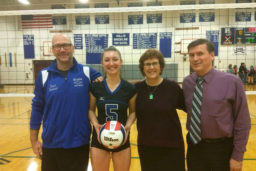 "Kyra Belden stands with her head coach, Rebecca Balfour, on the right, and assistant coach, Jake Balfour, on the left after her game on September 28. Kyra secured her 1000th career assist as a senior at HB. ""Thank you to my whole team for pushing me in practices and ingames to reach this goal,"" said Belden."