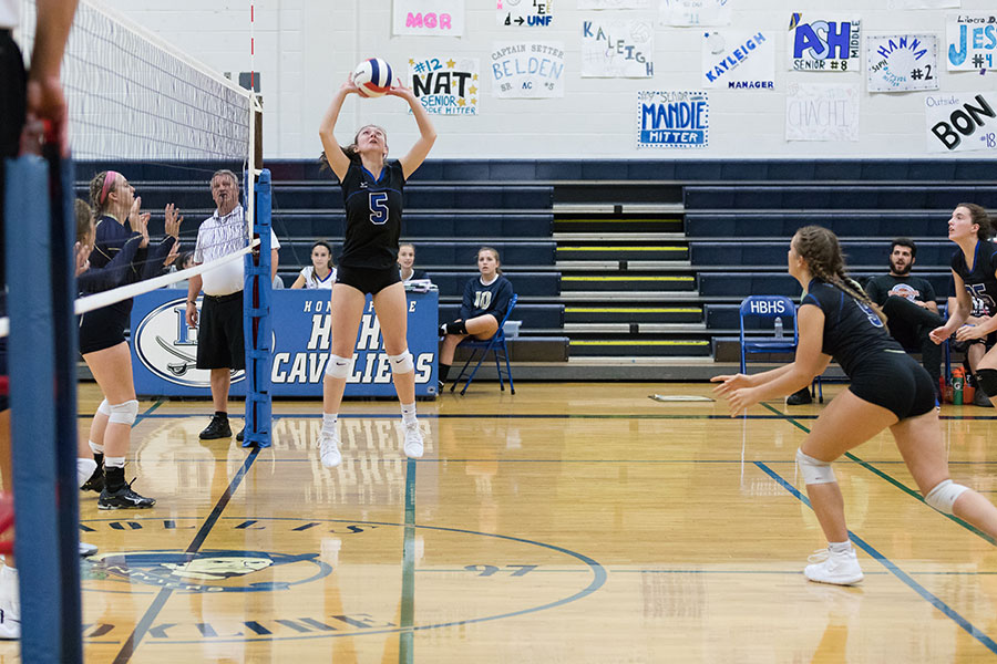 "Kyra Belden '19 is preparing to pass the ball to her teammates. Her and the rest of the varsity volleyball team are getting ready for the state championship tournament. ""[The team] is working on their skills, physical and mental, to get ready for the tournament,"" said Balfour."