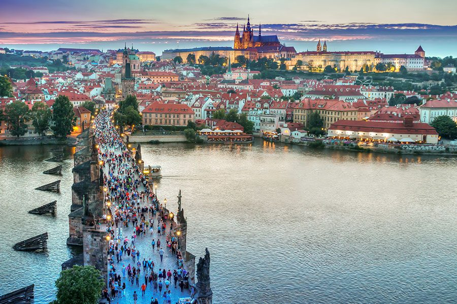 "This picture was taken in Prague, Czech Republic.  You can see the beautiful castle in the background, and the people enjoying this wonderful city.  This trip will feature this city, as well as Vienna, Austria, and Budapest, Hungary. ""To see a city that has existed through all those events and has been shaped by them,"" will help students connect more with their history learning, said Ellis."
