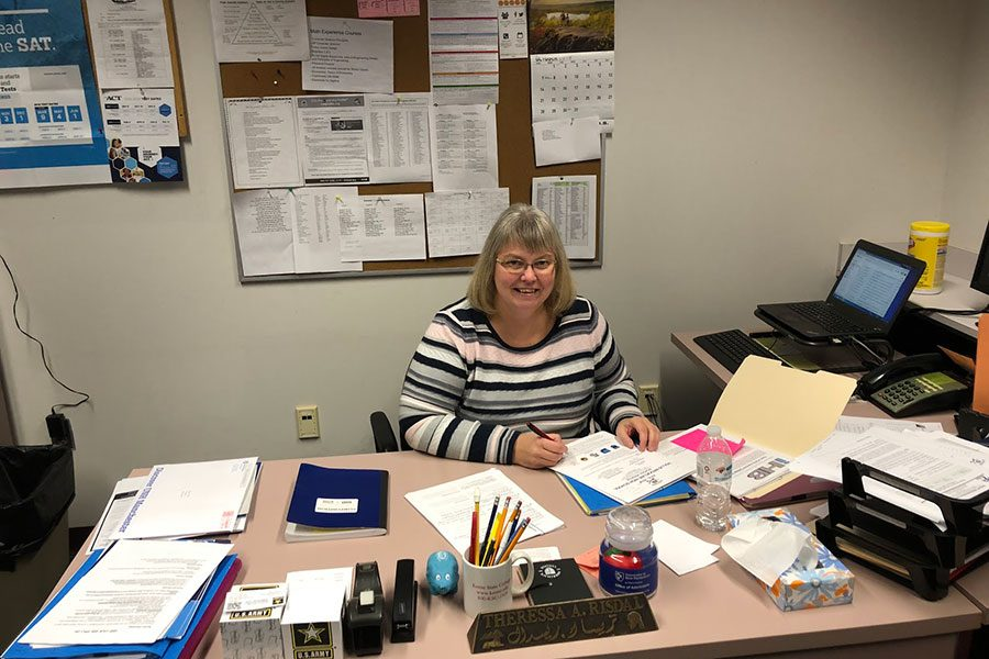 "Mrs. Risdal sits at her desk as she works on college apps.  This department can help with all issues including social, emotional, and academic.  ""This school counseling department is very dedicated to helping kids navigate through high school,"" said Theressa Risdal."