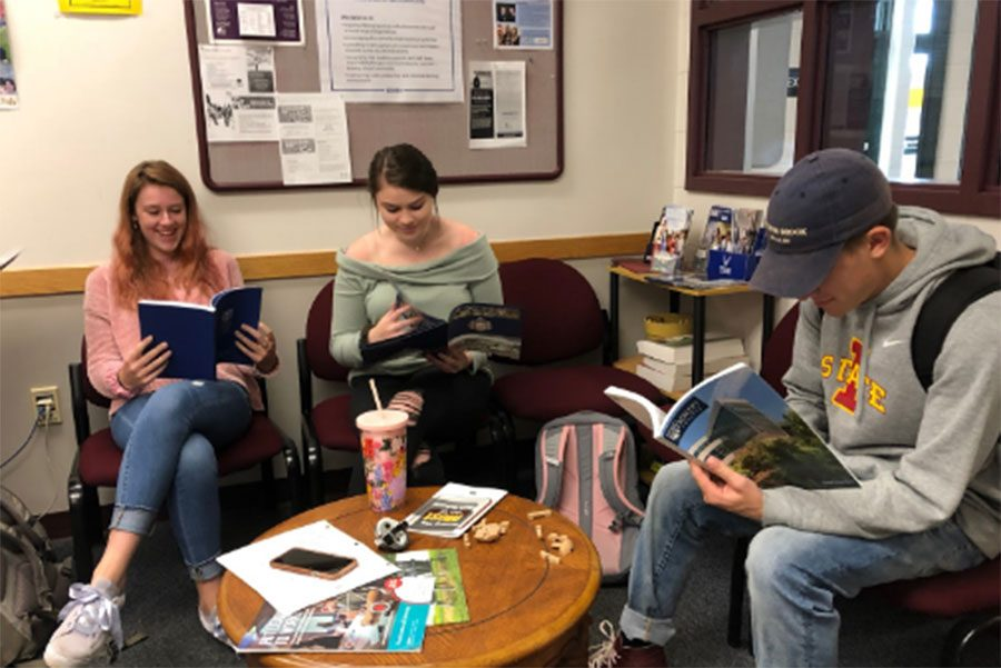 "Current seniors, Elise Ferguson, Kylie Whiting and Lucien Boudreau (respectively), sit patiently in the school counseling office. Waiting to talk to their counselors about the many opportunities that are in front of them. Elise said it best, ""Everything is so stressful, but taking it step by step helps a lot. It's not so overwhelming that way."""