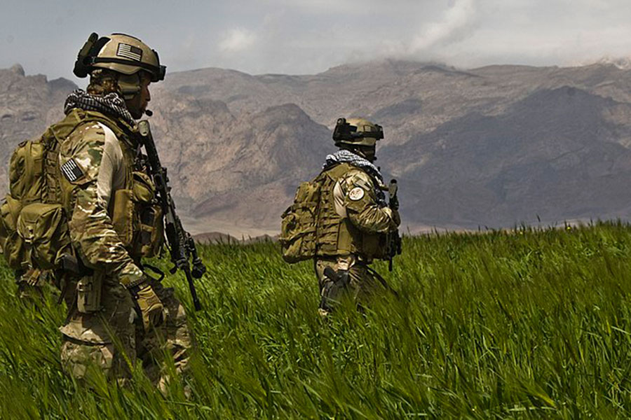 """Special Forces Soldiers from the 3rd Special Forces Group patrol a field in the Gulistan district of Farah, Afghanistan with Afghan National Army commandos from the 207th Kandak, April 12."" -Spc Joseph A Wilson"