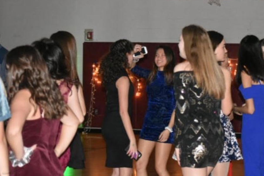 """Students dance at the Harvest Ball in the mini gym on Nov 2. """"There was more effort into planning it, so it's gonna be better,"""" Patel stated in the days leading up to the dance. Increased organisation and planning of the dance this year likely increased attendance at the event."""