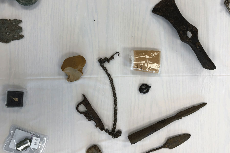 Carving tools, flint and steel, nails, and other survival items are seen here. Professor Newman claims items like these were crucial to survival in ancient times.