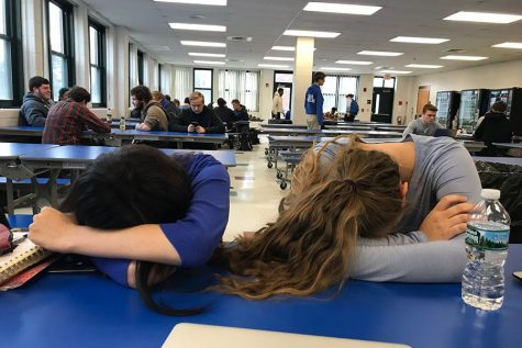 """Seniors Mia Fokas '19 and Mia Pickard '19 take a nap during Cav Block. For seniors, Cav Block is the perfect time to relax, eat, or finish a procrastinated assignment. """"If you wait last minute [to finish homework], Cav Block is amazing,"""" Pickard states."""