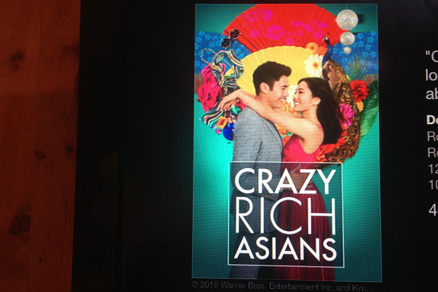 "The movie poster for Crazy Rich Asians is shown on the screen when renting the film. The movie was released into theaters last August, and was recently released for purchase or rental. The film is ""going to change Hollywood,"" according to Time magazine."