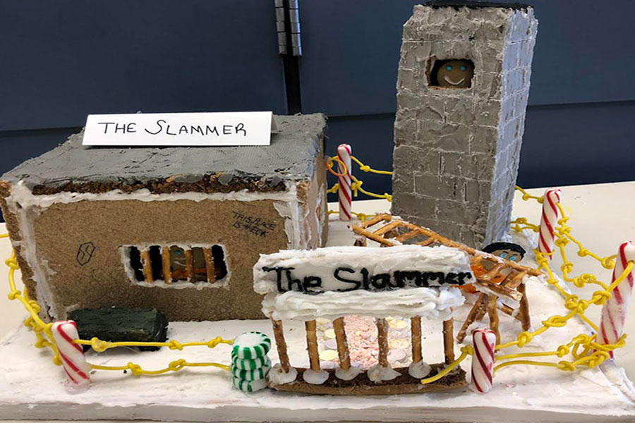 "The winning gingerbread house, titled ""The Slammer,"" was a miniature version of a prison, complete with pretzel fences and candy barbed wire. ""It was a great experience creating this masterpiece with my group,"" said Brodie Kelly '19, one of the creators of the winning gingerbread house. Her other group members included Natalie Cook '19, Ryan Coutu '20, and Chelsea Macnamara '19."