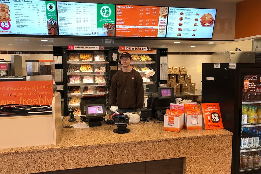 "Pictured here is  Sinclair during a shift at the Dunkin Donuts in Brookline, NH. Sinclair finds that having a job isn't as bad as he thought it would be. ""I have a relatively low stress job which makes it a ton easier,"" said Sinclair."